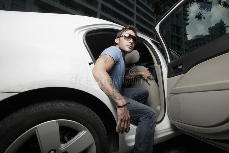 Download Rock Star Getting Out Of His Car Stock Image - Image: 10261367