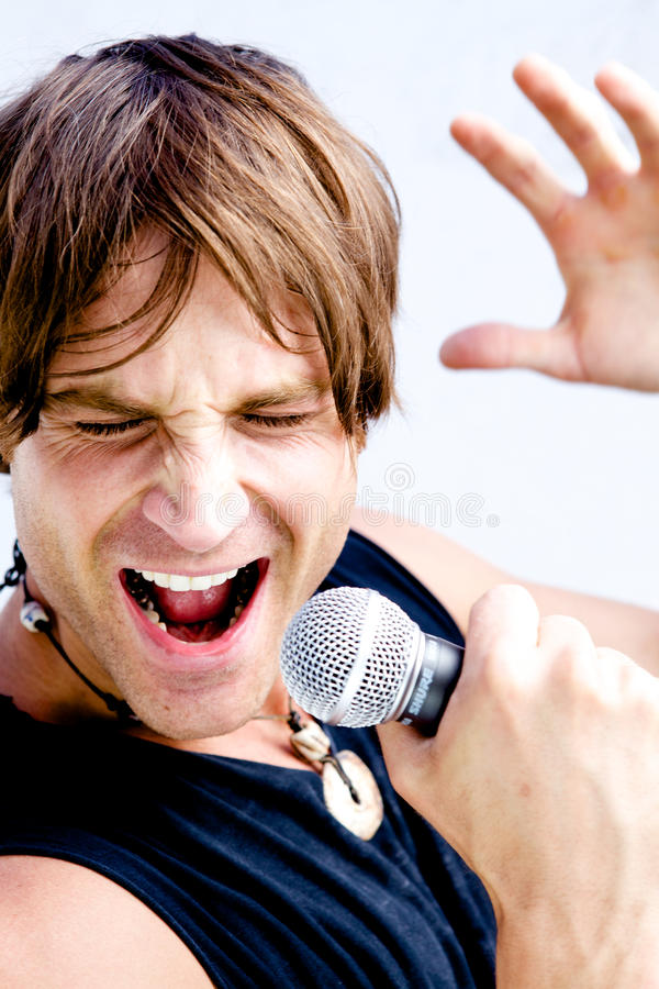 Rock Star Jamming Out. A Rock Star Jamming out with a microphone royalty free stock photography