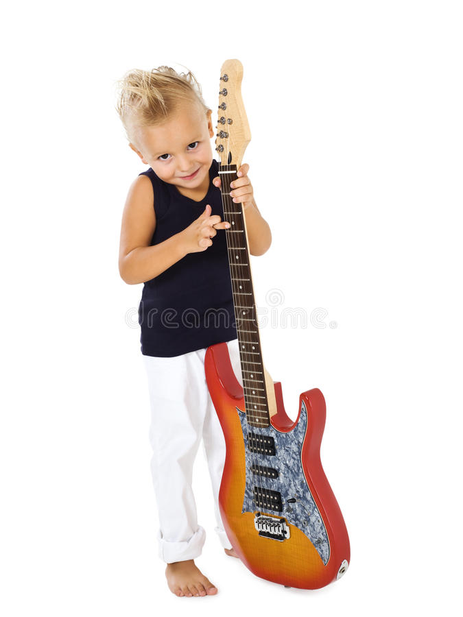 Rock star kid. With electric guitar royalty free stock images