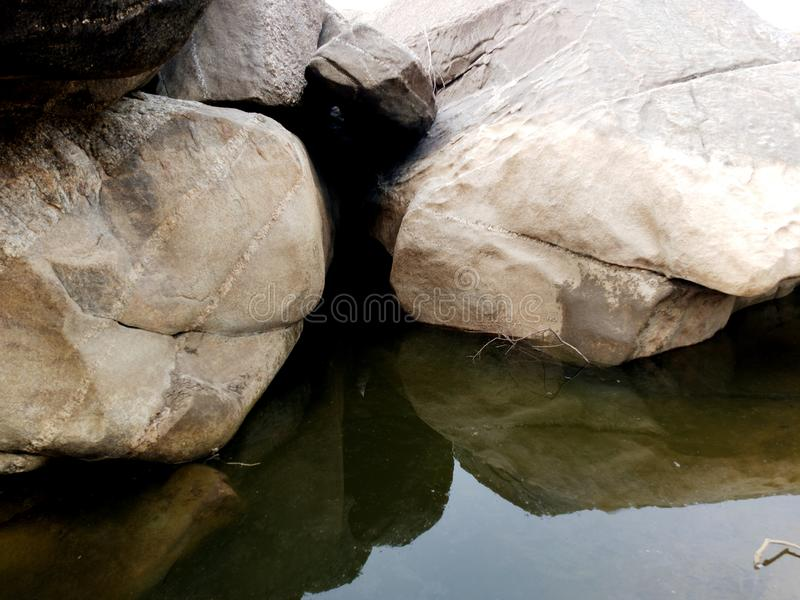 Rock or stone texture in the river landscape background. stock images