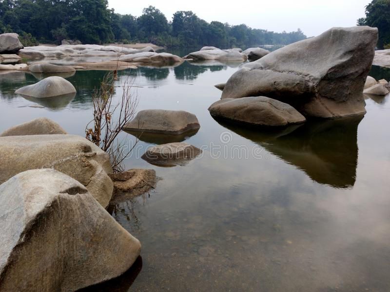 Rock or stone texture in the river landscape background. stock photography