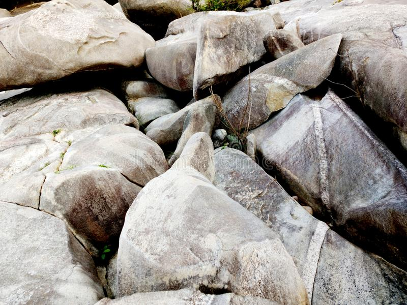 Rock or stone texture in the river landscape background. royalty free stock images