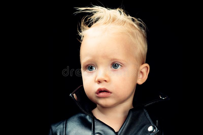 Rock style child. Rock and roll fashion trend. Adorable small music fan. Music for children. Little rock star. Little. Child boy in rocker jacket. Born to be royalty free stock image