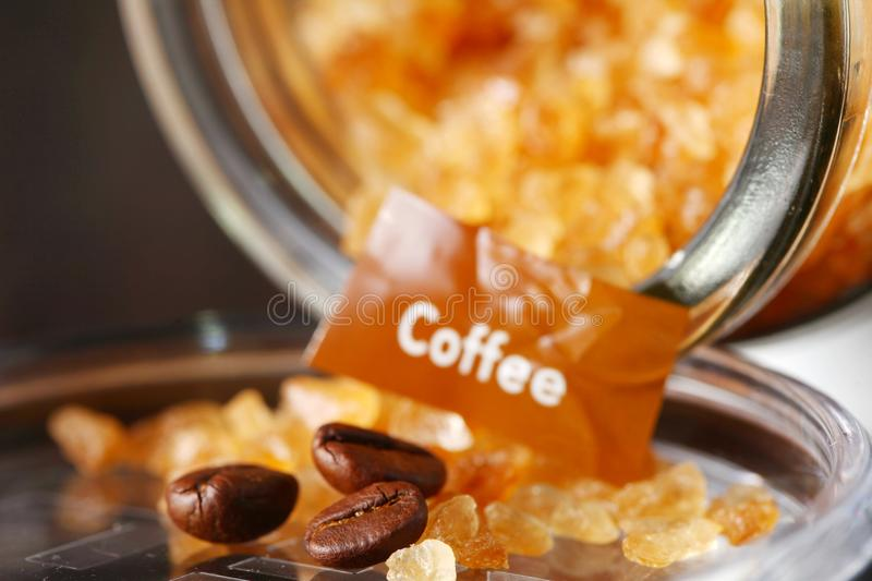 Rock sugar and coffee beans. royalty free stock image