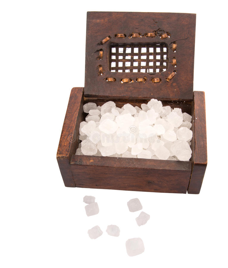 Rock Sugar II. A group of rock sugar in a wooden box stock image