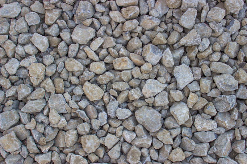 Rock texture background 3. A close up view of ground texture consisting of brown and grey rocks of various sizes throughout entire area stock photography