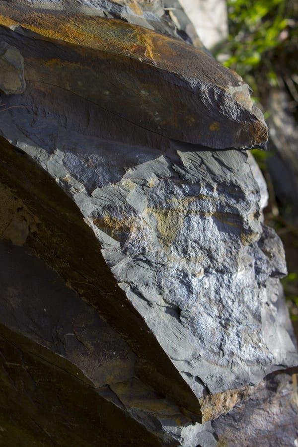 Rock texture grey brown. Fractured broken rock texture with grey and brown stock images
