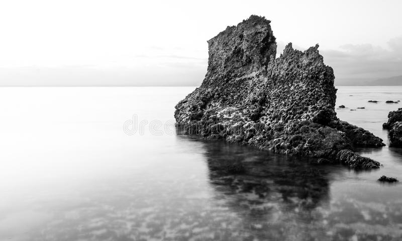Rock in the tide royalty free stock photo
