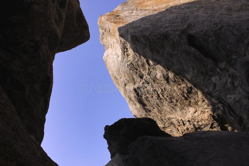 Rock top with blue sky stock photography