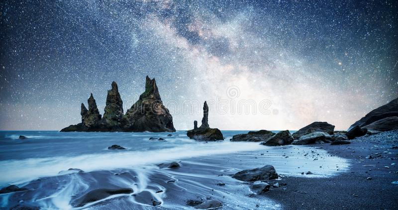 The Rock Troll Toes. Reynisdrangar cliffs. Black sand beach. Iceland. Fantastic starry sky and the milky way royalty free stock photos