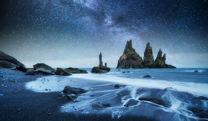 The Rock Troll Toes. Reynisdrangar cliffs. Black sand beach. Iceland. Fantastic starry sky and the milky way stock photos