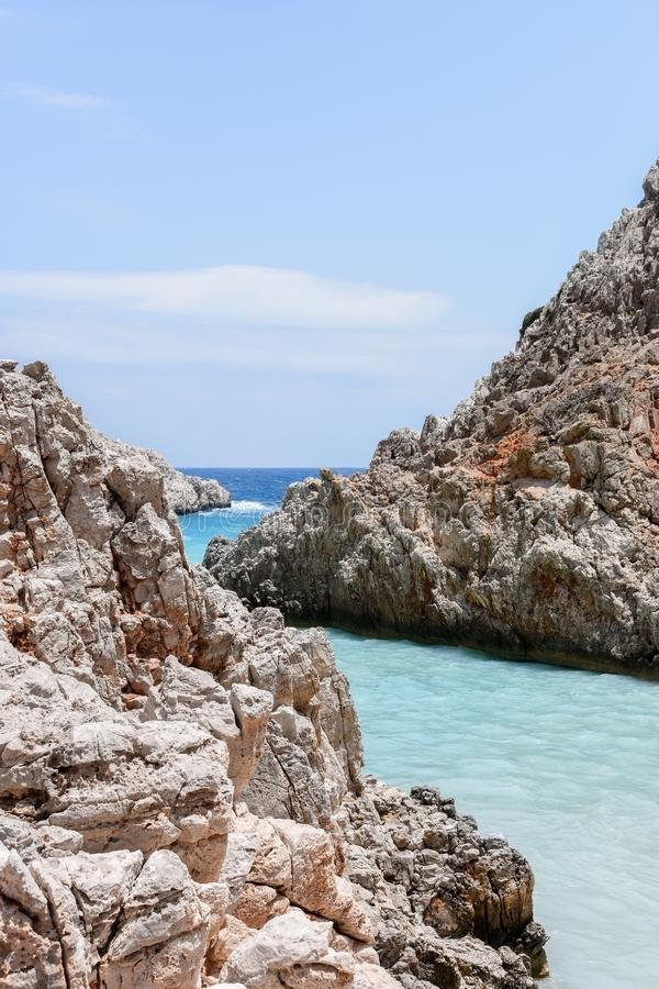 Rock and turquoise water at Seitan Limania Beach, Crete Island stock photo