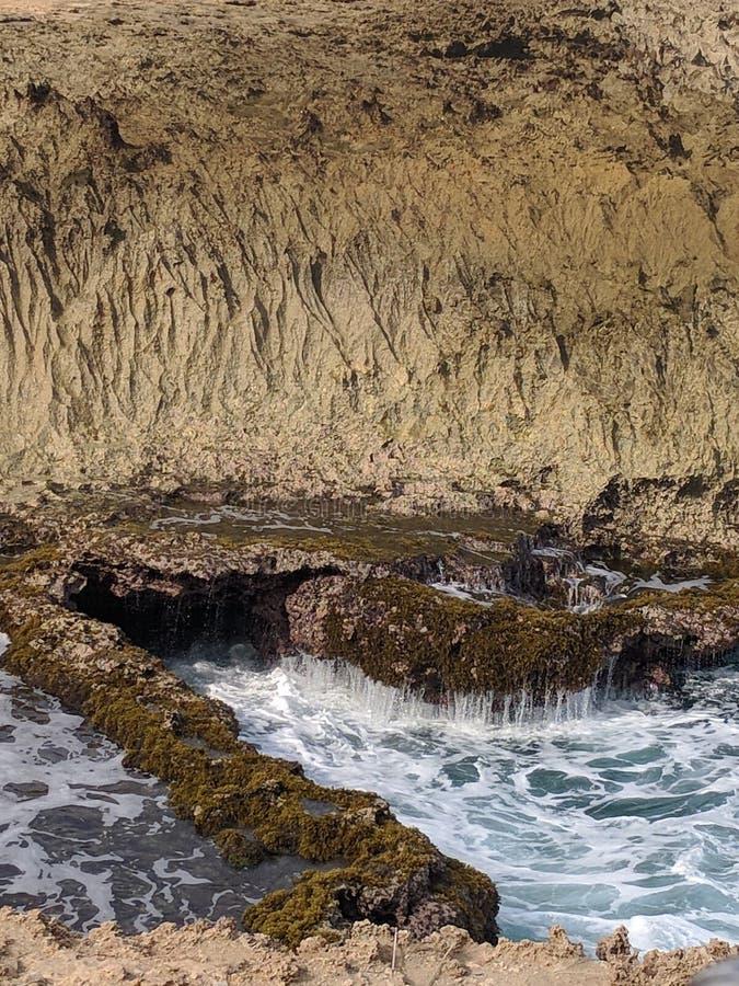 Rock Wall Above Ocean stock image