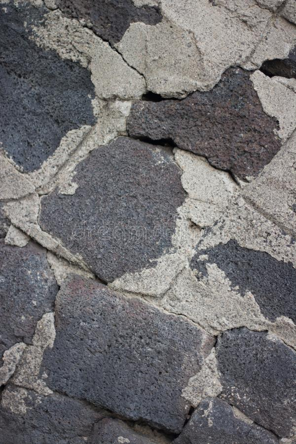 Rock wall with cracking mortar stock image