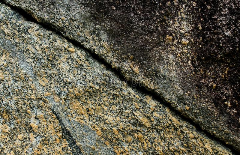 Rock wall fissure texture. This photograph was taken in Matinhos, Paraná, Brazil. March 29, 2018 stock image