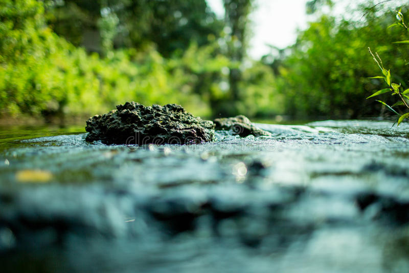 The rock in the waterway.  stock image
