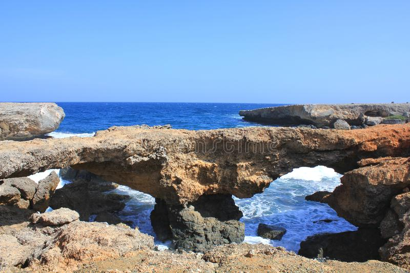 Rock windows formation on Aruba island royalty free stock photography