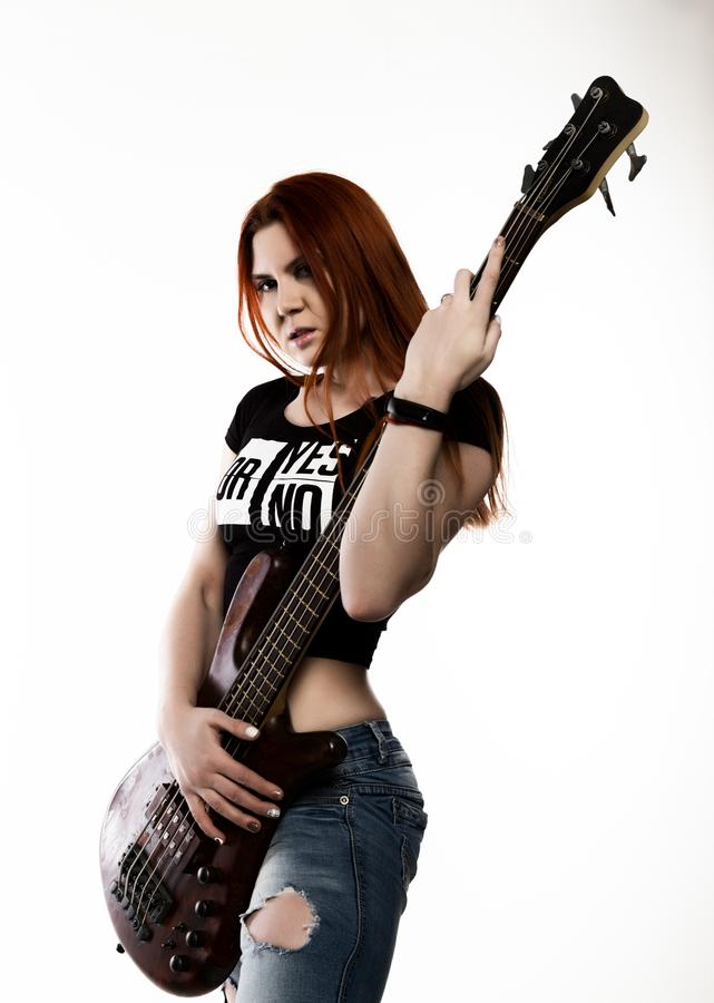 Rock woman playing on electric guitar on a white background. royalty free stock photography