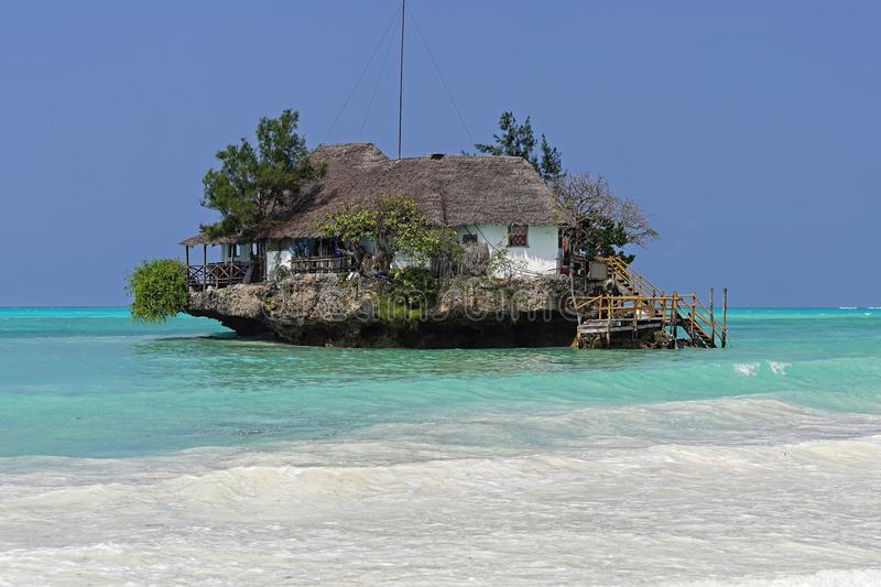 Rock in Zanzibar. Restaurant on small rock island in Zanzibar Tanzania royalty free stock photography
