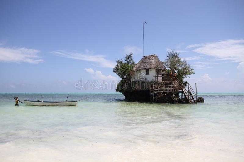 The Rock Zanzibar. The Rock restaurant Zanzibar Tanzania during high tide stock image