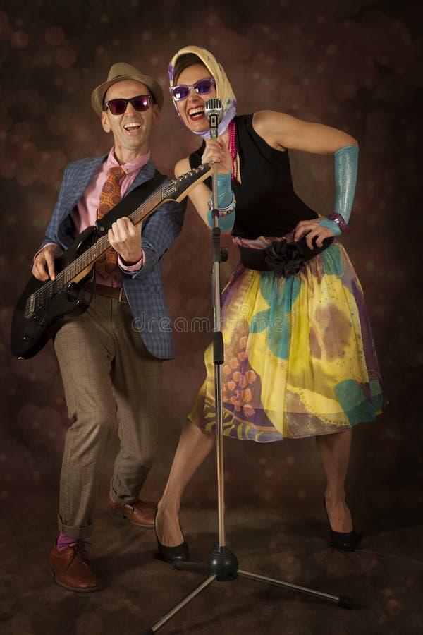 Rockabilly couple having fun royalty free stock photography