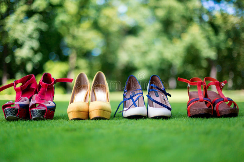 Rockabilly hen-party in park. Girls shoes on the grass stock image