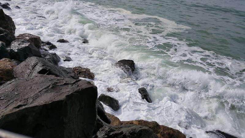 Rockaway Beach, Pacifica, California. View of the Pacific Ocean crashing on the rocks at Rockaway Beach, Pacifica, California royalty free stock image