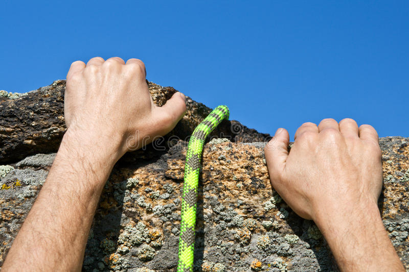 Download Rockclimber's Hands And Rope Stock Photo - Image: 23557870