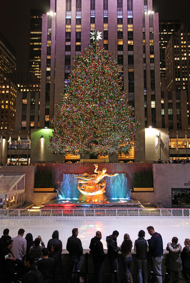Rockefeller Center skating rink and Christmas tree by night. New York, USA. Christmas skating rink and tree with Prometeus statue in Rockefeller Centre by night stock photography