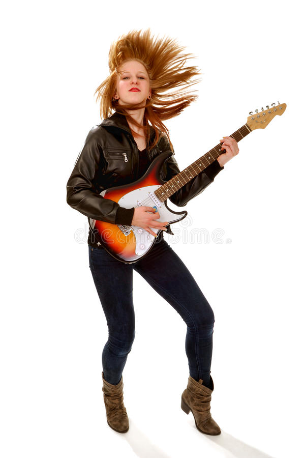 Rocker Chick with Electric Guitar. Tossing Her Hair royalty free stock image
