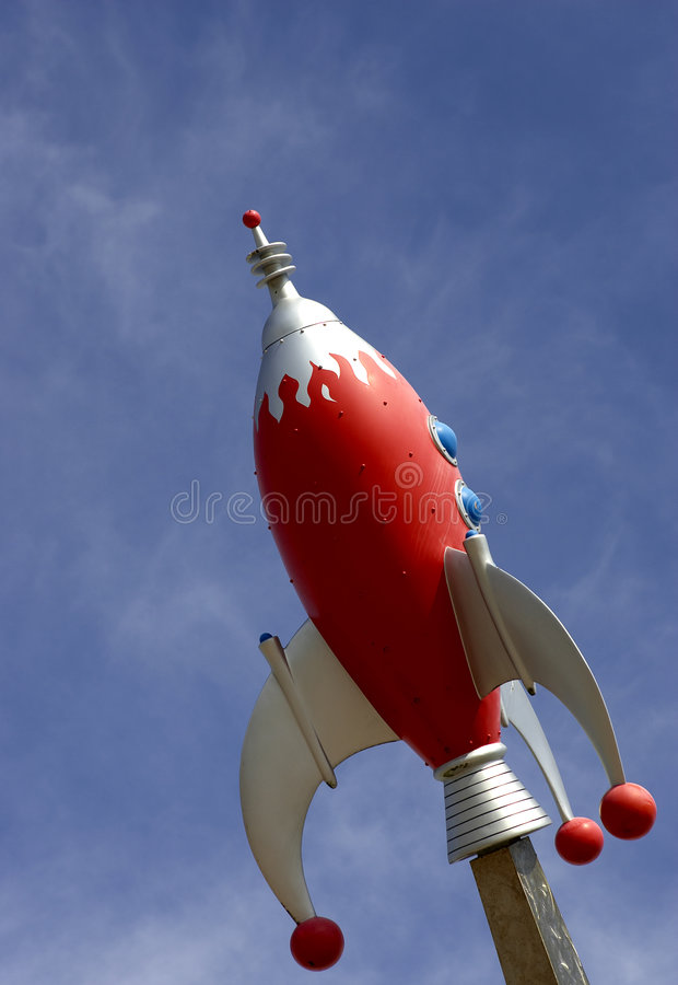 Rocket against blue sky. Horizontal stock photos