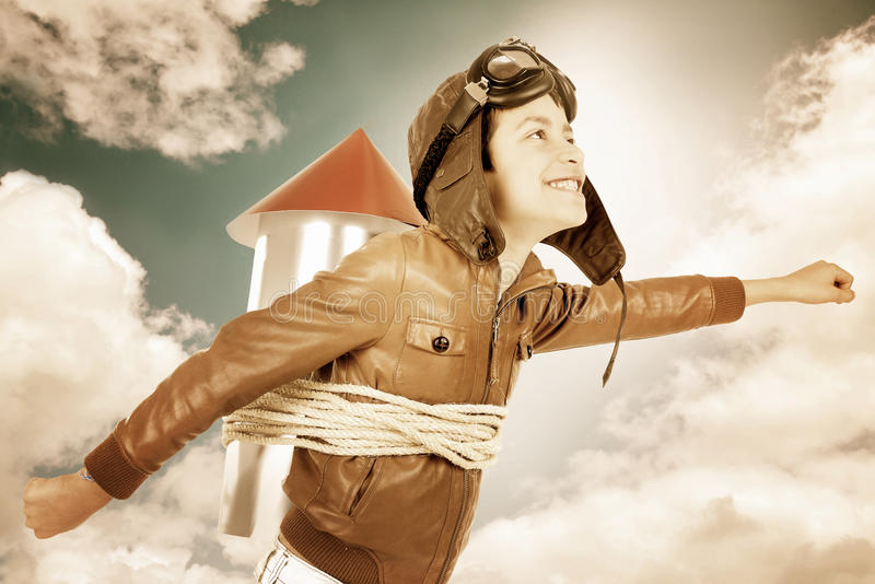 Rocket boy. Young boy with home made rocket ready for adventure royalty free stock photo