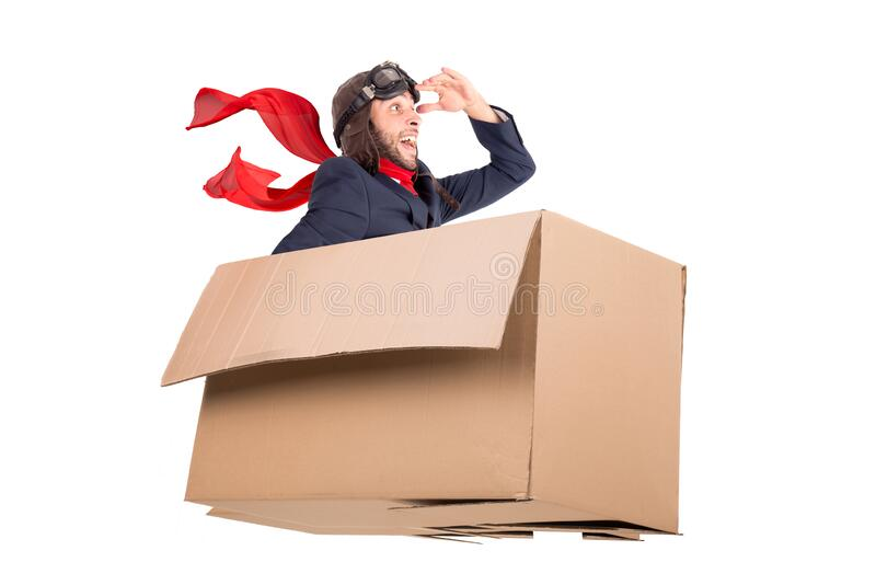 Flying businessman in a cardboard box stock photography