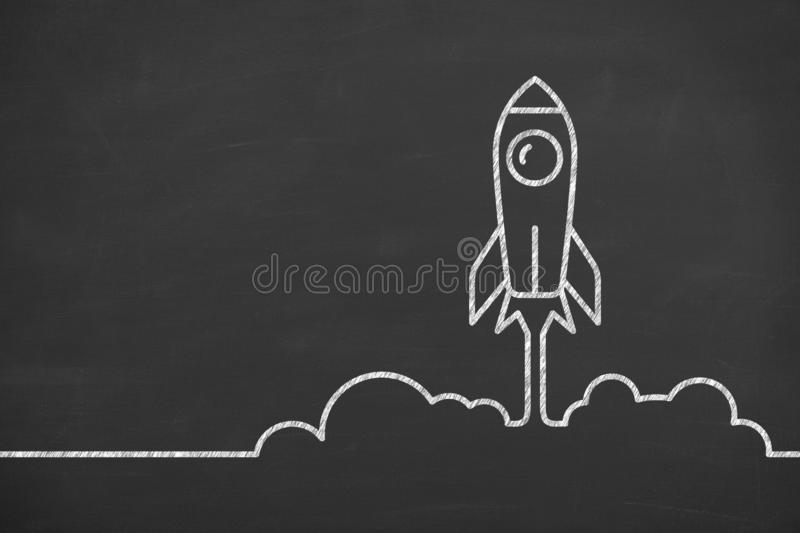 Rocket icon launching from floor startup concepts on blackboard background. Business working concepts stock photos