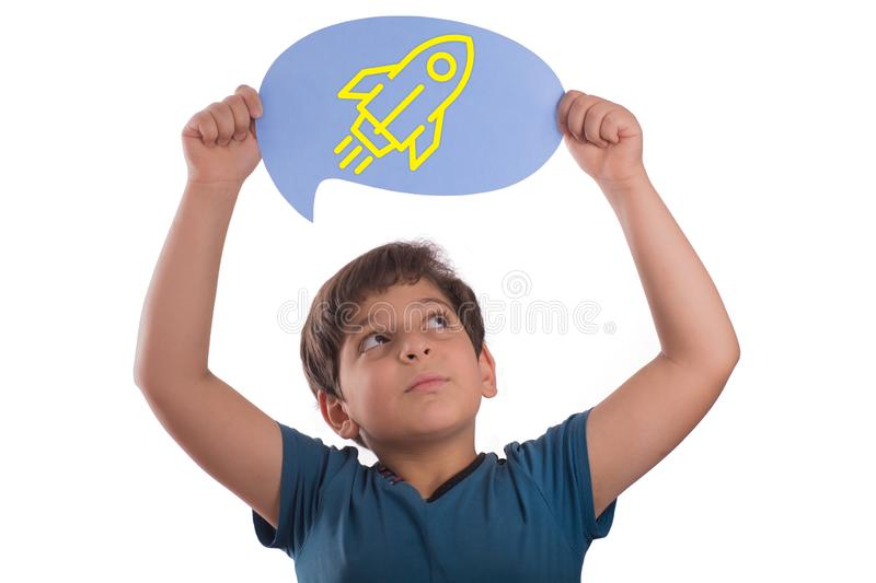 Rocket icon on thought bubble. A smart boy holding thought bubble top of head with Rocket icon , isolated on white background stock photos