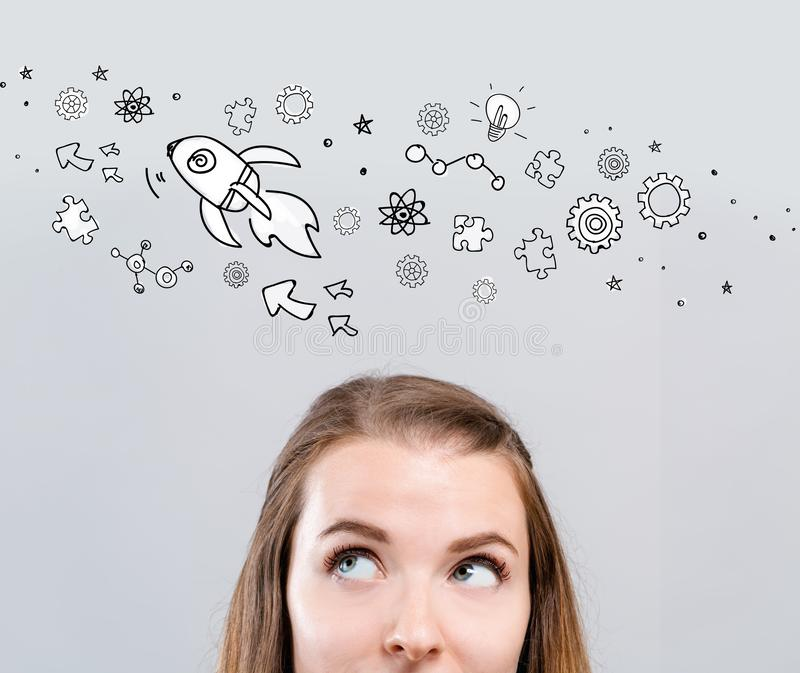 Rocket illustration with young woman royalty free stock photo