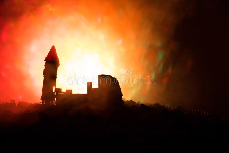 Rocket launch with fire clouds. Battle scene with rocket Missiles with Warhead Aimed at Gloomy Sky at night. Rocket vehicle on War stock photo