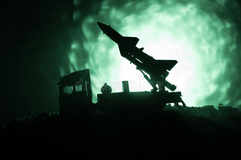 Rocket launch with fire clouds. Battle scene with rocket Missiles with Warhead Aimed at Gloomy Sky at night. Rocket vehicle on War stock images