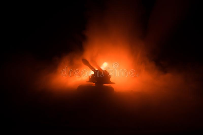 Rocket launch with fire clouds. Battle scene with rocket Missiles with Warhead Aimed at Gloomy Sky at night. Rocket vehicle on War royalty free stock photo