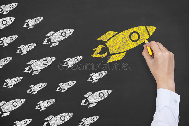 Rocket Leadership Concept on Blackboard. Working Conceptual Business Concept stock photography