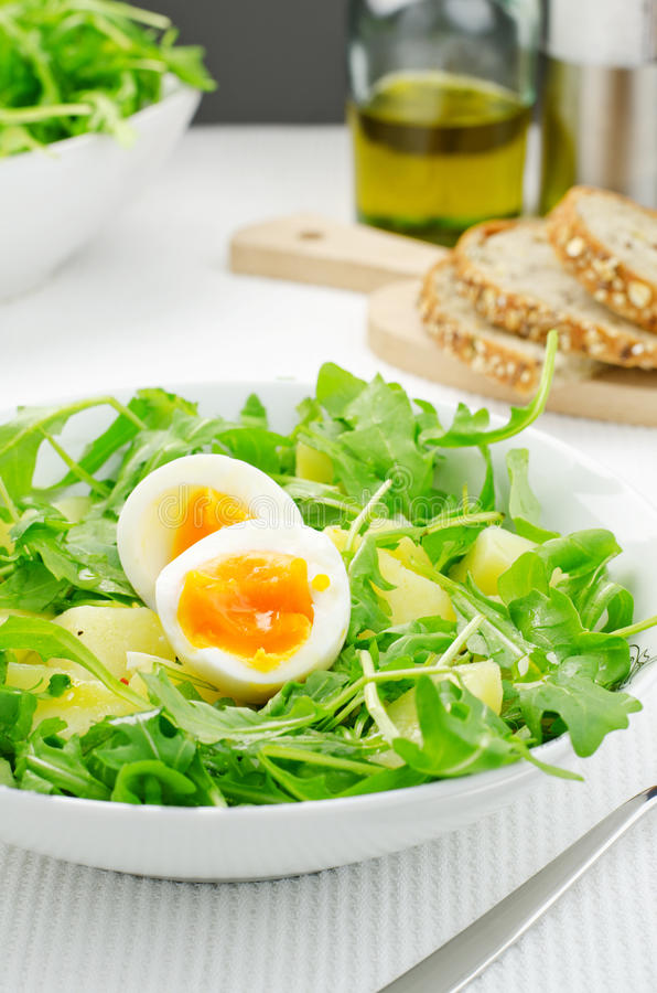 Rocket salad with potatoes and eggs. Salad with rocket salad, potatoes and eggs royalty free stock images