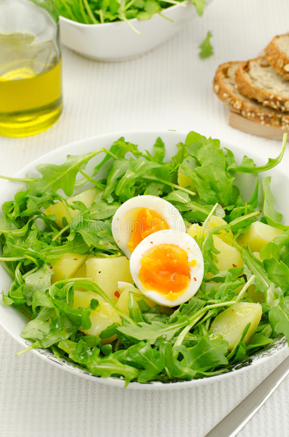 Rocket salad with potatoes and eggs. Salad with rocket salad, potatoes and eggs stock image