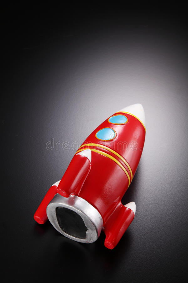 Rocket shape coin box royalty free stock photo