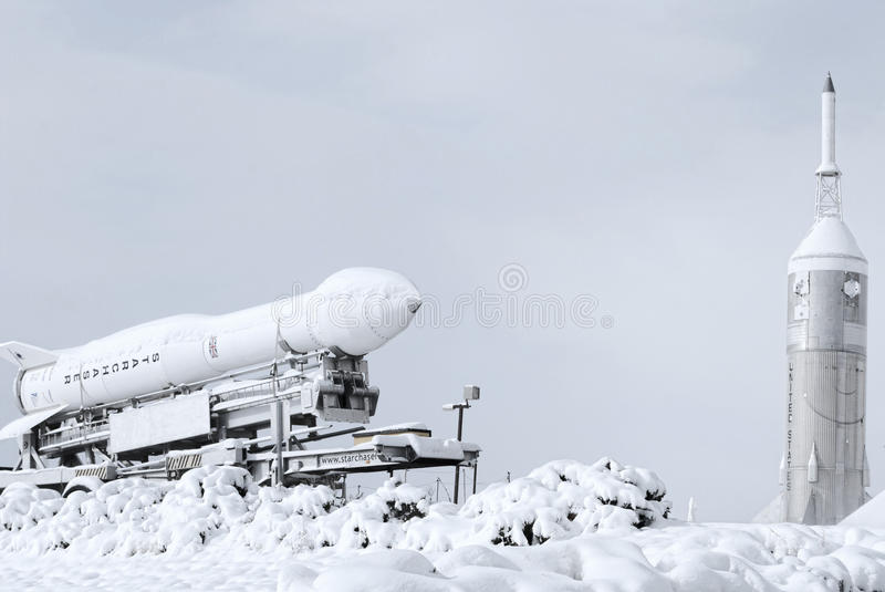 Rocket and shuttle covered in snow at a space museum. Space Museum in Alamogordo New Mexico. Rocket and shuttle covered in snow stock image