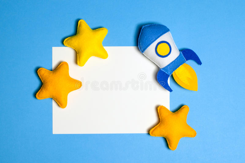 Rocket takes off. Hand made felt toys. Space ship with yellow stars on lue background. Rocket takes off. Space ship with yellow stars on lue background. Hand royalty free stock photo