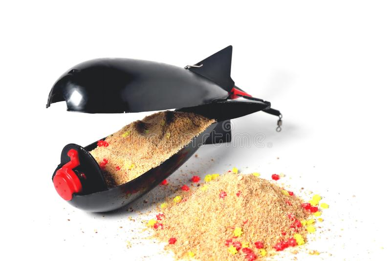 Rocket-type fishing trough with food inside for long distance feeding close up. White background royalty free stock photos