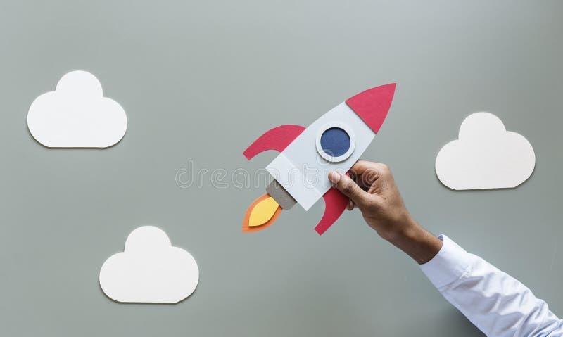 Rocketship van de start handholding zaken stock foto