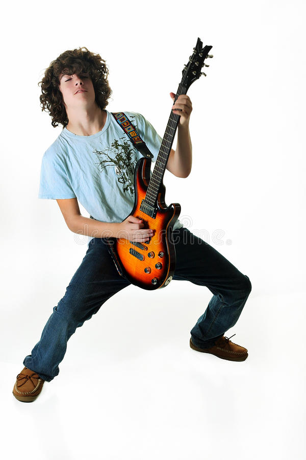 Rockin de l'adolescence sur la guitare image stock