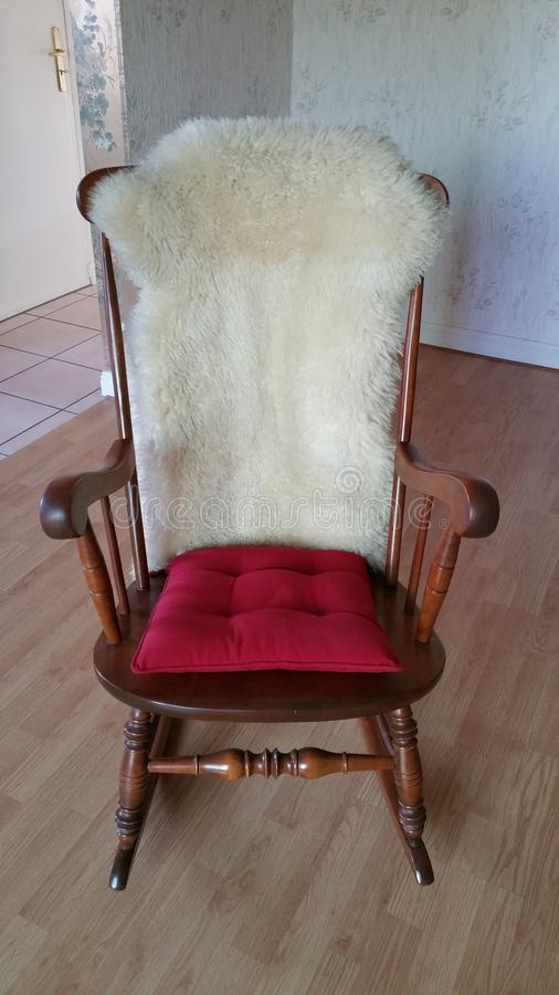 Genial Download Rocking Chair With Red Cushion On Seat And Sheepskin On Chair Back  Stock Image