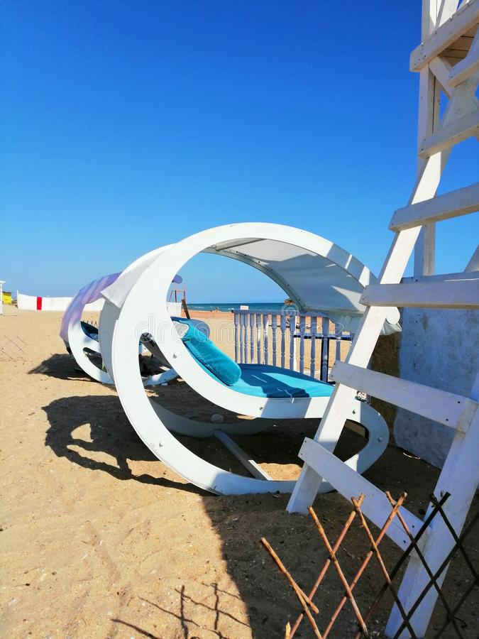 Rocking chair on the sand stock photo